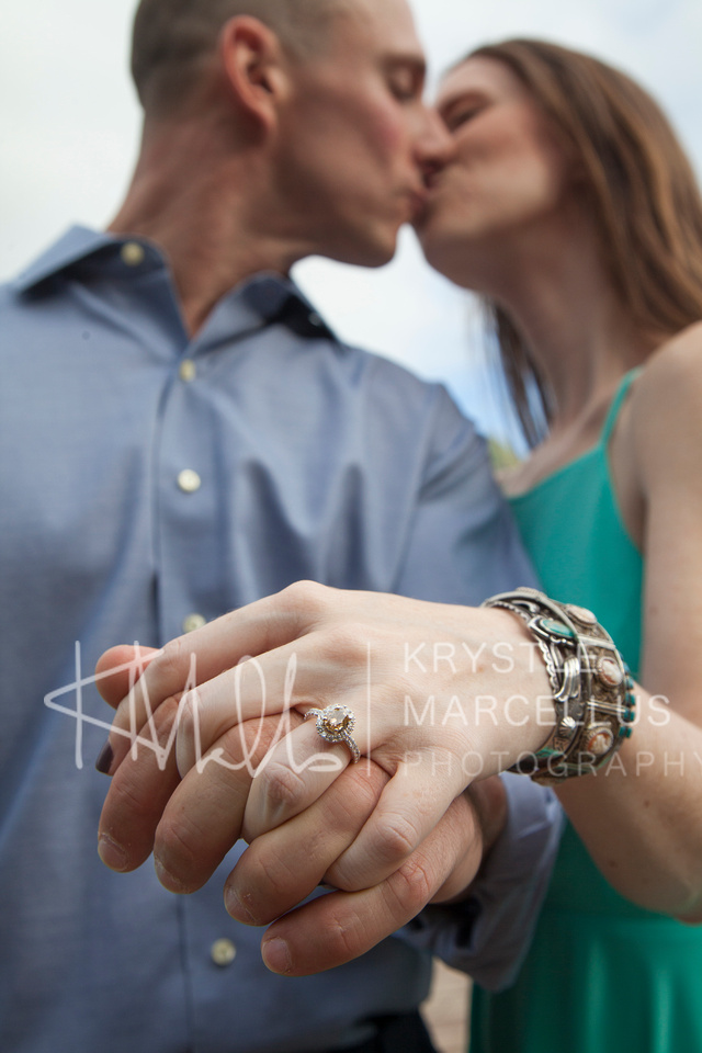 Engagement Portraits Session at Chinaman's Hat Beach Park in Hawaii, Windward Oahu with beautiful engagement ring